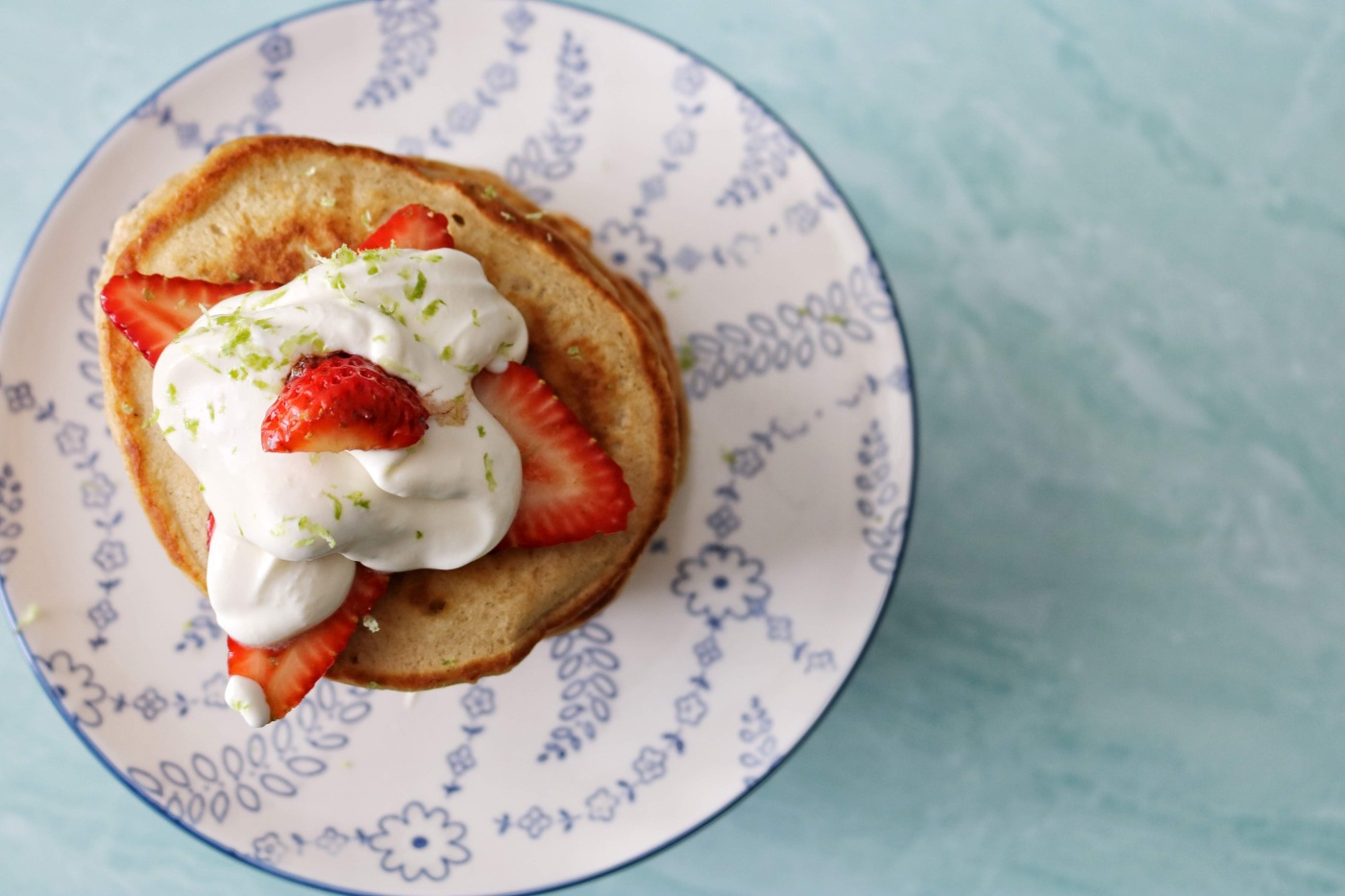 Cardamom pancakes with balsamic strawberries & limey labne whipped cream.